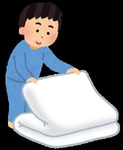 布団をたたんでいる人のイラスト
